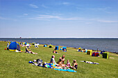 People on dyke, Pellworm Island, North Frisian Islands, Schleswig-Holstein, Germany