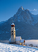 Saint Valentine's church on a sunny day in winter, Siusi, South Tyrol, Italy, Europe