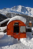 Snow covered bivouac in front of the guesthouse Yak & Yeti, Sulden, Val Venosta, South Tyrol, Italy, Europe