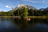 Lake with rowing boat, Voelser Weiher, Voels am Schlern, South Tyrol, Italy