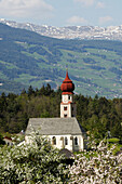 Church of St Oswald with onion dome in Spring, St Oswald, Kastelruth, Castelrotto, Schlern, South Tyrol, Italy
