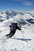 Person on a ski tour descending the mountain, Mountain landscape, Seiser Alp, Durontal, Molignon, Saltria, South Tyrol, Italy