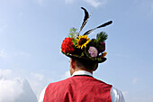 Shepherd with Traditional clothing, hat, Returning to the valley from the alpine pastures, Seiser Alm, South Tyrol, Italy