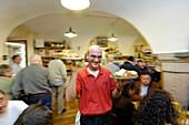 Waiter and restaurant guests Osteria Dai Carrettai, Bolzano, South Tyrol, Italy