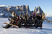 Group photograph, men on a sledge, Nostalgia, Seiser Alm, Schlern, South Tyrol, Italy