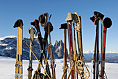 Wooden skis with hats in a winter mountain landscape, Nostalgia, Seiser Alm, Schlern, South Tyrol, Italy