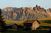 Wooden hut in the middle of an alpine pasture, Seiser Alm, Schlern, South Tyrol, Italien