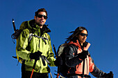 Young couple wearing winter clothing in front of blue sky, Schnals valley, Val Venosta, South Tyrol, Italy, Europe