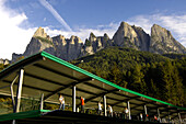 People on the driving range of golf court Kastelruth Alpe di Siusi, Sciliar, South Tyrol, Italy, Europe