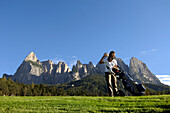 A woman pulling a club out of her golf bag, Golf court Kastelruth Alpe di Siusi, Sciliar, South Tyrol, Italy, Europe