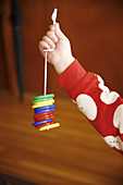 Arm, Arms, Boy, Boys, Child, childhood, Children, Color, Colored, Colorful, Colors, Colour, Coloured, Colourful, Colours, Contemporary, Cord, Cords, detail, details, hand, hands, Hang, Hanging, Hold, Holding, human, indoor, indoors, infancy, Infant, Infan
