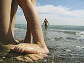 Adult, Adults, Affection, Anonymous, Barefeet, Barefoot, Beach, Beaches, Bond, Bonding, Bonds, Child, Children, Color, Colour, Contemporary, Daytime, Detail, Details, Exterior, Families, Family, Feet, Fondness, Foot, Holiday, Holidays, Human, Infant, Infa