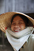 Adult, Adults, asian, asians, Close up, Close-up, Closeup, Color, Colour, Contemporary, Daytime, Ethnic, Ethnicity, exterior, female, grin, grinning, Hat, Hats, Head & shoulders, Head and shoulders, Headgear, human, outdoor, outdoors, outside, people, per