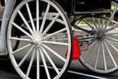 Close up of wheels on a horse-drawn carriage, Central Park, NY, NY, USA