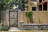 Rustic, weather-beaten gate and walls