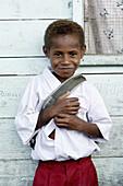 Smiling boy in school uniform, Indonesia