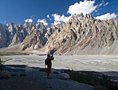 Traveler admires the magnificent Passu Cathedrals, Karakoram Range, Pakistan