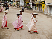 Nuns walking on their morning alms rounds in the old city of Bagan in Myanmar