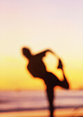 Runner, stretching, beach, Santa Barbara, CA, USA.