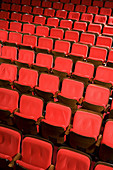 Arrangement, Auditorium, Auditoriums, Chair, Chairs, Color, Colour, Concept, Concepts, Contemporary, Deserted, Empty, Indoor, Indoors, Interior, Line, Lined up, Lined-up, Lines, Lining up, Lining-up, Many, Nobody, Order, Perspective, Red, Row, Rows, Seat,