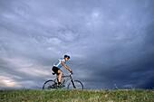 Young man riding a mountain bike