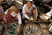 The markets in Cambodia are always colorful with a lot of action. People smile as a busy day goes by.