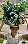 With a big smile this young lady sells the sweetest pineapples in one of the train stations on the way to Lashio. Myanmar (Burma)