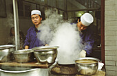 The Muslim Chefs in a local small restaurant in Xian's old muslim quarter, China