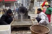 Roasting the sunflower seeds in a small street market in Nanjing, China