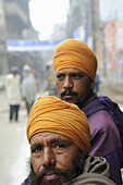 Early morning in Amritsar, Punjab, India  Sikh men sit on their cycle rickshaw waiting for their hot tea to be served