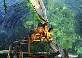 Bajau children (sea gypsies), nomads of the Indonesian seas. They live in boats and keep houses in steady places where they spend the rainy season. Indonesia.