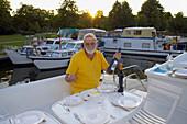 Man on a houseboat, Templin, Brandenburg, Germany