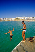 Teenagers jumping into the water of the port basin, Albufeira, Algarve, Portugal, Europe