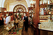 Guests and a waiter at the bar of the Gilli Cafe, Piazza della Republica, Florence, Tuscany, Italy, Europe