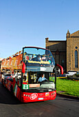 City Sightseeing, double decker bus with tourists under blue sky, Florence, Tuscany, Italy, Europe