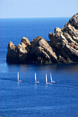 Sailing boats from a sailing school from Fornells at Cap de Fornells, Minorca, Balearic Islands, Spain