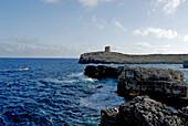 Rocky coast and old tower at the Cala d´Alcaufar, Minorca, Balearic Islands, Spain