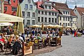 People sitting in a cafe at Raekoja Plats, town hall square, Tallinn, Estonia