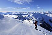 Female backcountry skier enjoying view over Zillertal, Galtenberg, Kitzbuehel Alps, Tyrol, Austria