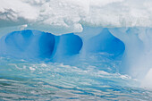 Whimsical ice caves formed by wind and sea in this iceberg detail in and around the Antarctic Peninsula during the summer months  More icebergs are being created as global warming is causing the breakup of major ice shelves and glaciers