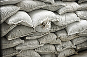 Stacked construction white sand bags