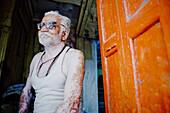 50 to 55 years, 50 to 60 years, 50-55 years, 50-60 years, Disorder, Face, Fifties, Ghat, Ghats, Glasses, India, Man, Portrait, Religion, Sitting, Skin, Smile, Varanasi, Vitiligo, F17-704596, agefotostock