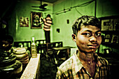 10 to 15 years, 10-15 years, Boy, Cleaning, Dishes, Face, India, Kitchen, Portrait, Shop, Smile, Sweat, Working, F17-704598, agefotostock