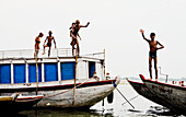 10 to 15 years, 10-15 years, Bathing, Boats, Boys, Counting, Diving, Fingers, Ganga, Ganges River, India, Naked, Religious, River, Smile, Varanasi, Water, Waving, F17-704600, agefotostock