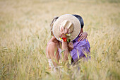 Adult, Adults, Bond, Bonding, Bonds, Color, Colour, Contemporary, Country, Countryside, couple, couples, Cover, Covering, Daytime, embrace, embracing, exterior, female, Grass, Grasses, Hat, Hats, Headgear, hug, hugging, human, kiss, kisses, kissing, Leisu