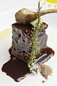 Stewed veal ham with mencia sauce and artichokes at restaurant A Rexidora by Javier Gonzalez, Bentraces. Orense province, Galicia, Spain