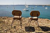 Chairs at Cala Saona, Formentera. Balearic Islands, Spain