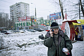 Man using cell phone, Moscow, Russia