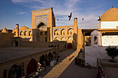 Cityscape of Madrassas (islamic schools) and Mosques of old Khiva at sunset, Khiva, Uzbekistan