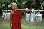 Buddhist novice collecting alms, taungoo region